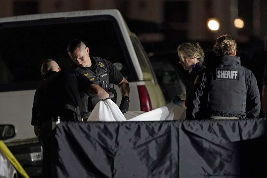 The body of Michael Reinoehl is lifted onto a stretcher in the early morning hours of Friday, Sept. 4, 2020, in Lacey, Wash. Reinoehl was killed Thurs...