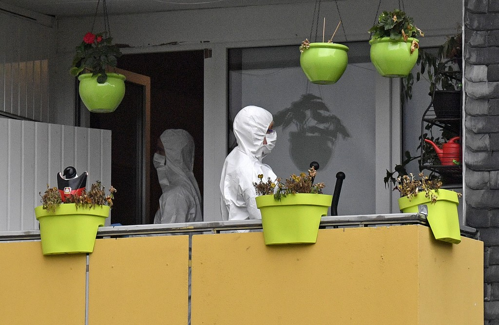 Forensic scientists investigates an apartment, where five dead children were found in Solingen, Germany, Friday, Sept. 4, 2020. Police say five young ...