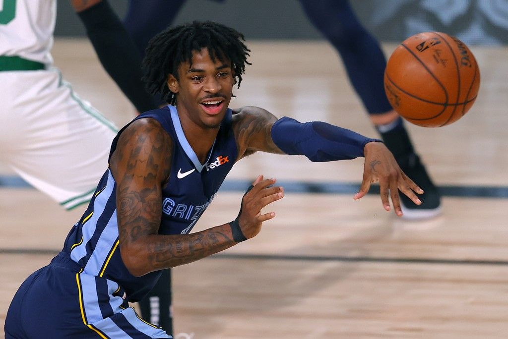 FILE - In this Aug. 11, 2020, file photo, Memphis Grizzlies' Ja Morant passes the ball during the second half of an NBA basketball game against the Bo...
