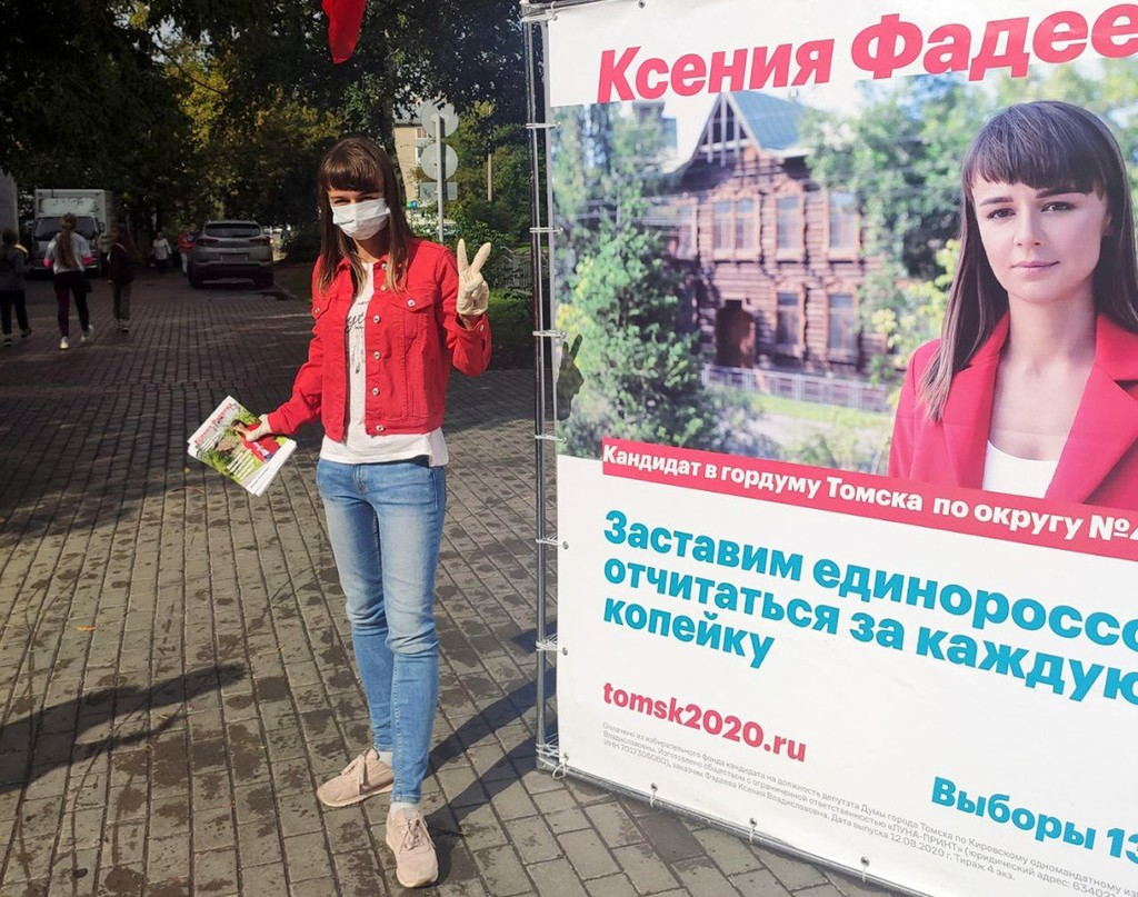 In this August 2020 photo provided by Alexei Navalny's team, Ksenia Fadeyeva, who is running for the city council in Tomsk, Russia, poses for a photo ...
