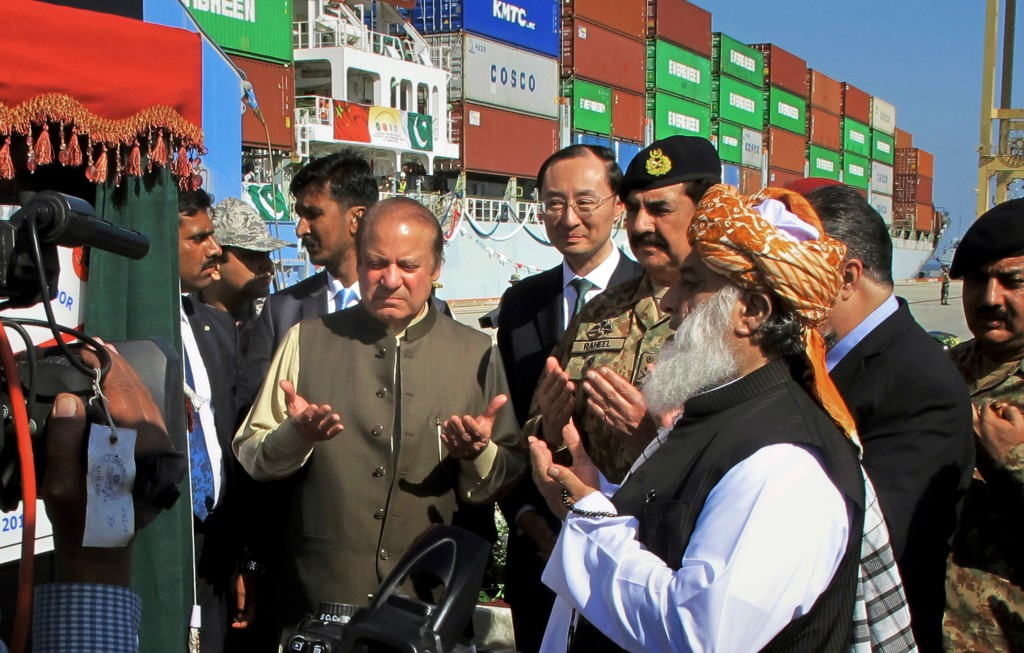 FILE - In this Nov. 13, 2016 file photo, Pakistan's Prime Minister Nawaz Sharif, center left, and Army Chief Gen. Raheel Sharif, fourth right, pray ne...