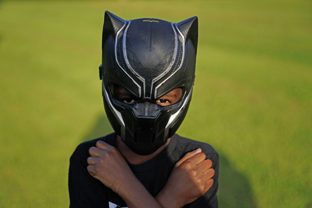 Black Panthers fan, Keyon Griffin, 7, of South Carolina, poses for a portrait during a Chadwick Boseman Tribute on Thursday, Sept. 3, 2020, in Anderso...