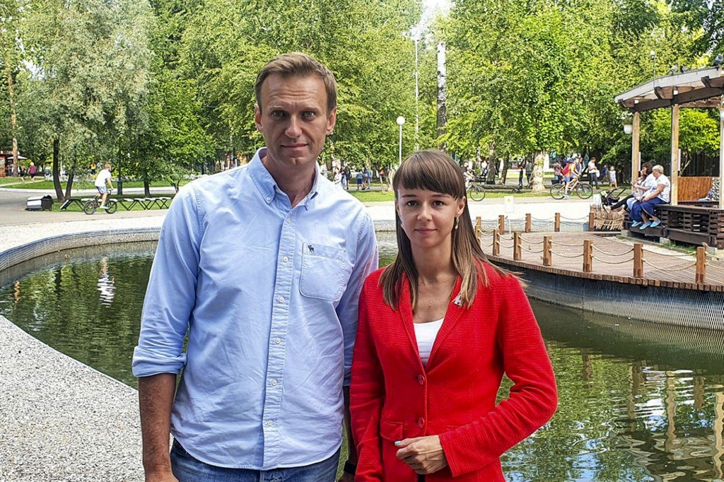 In this August 2020, photo, provided by Alexei Navalny's team, Ksenia Fadeyeva poses for a photo with Alexei Navalny in Tomsk, Russia. Fadeyeva runs t...