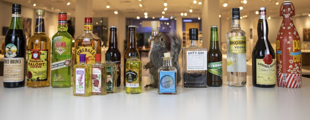 In this photo dated Tuesday, Aug. 25, 2020, made available by Disgusting Food Museum, a selection of drinks, including coca leaf liqueur, ant gin, fis...