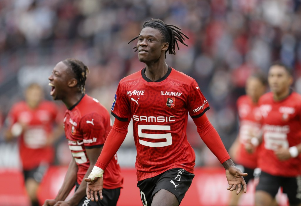 FILE- In this Saturday, Aug. 29, 2020 file photo, Rennes' Eduardo Camavinga celebrates after scoring his side's second goal during the League One socc...