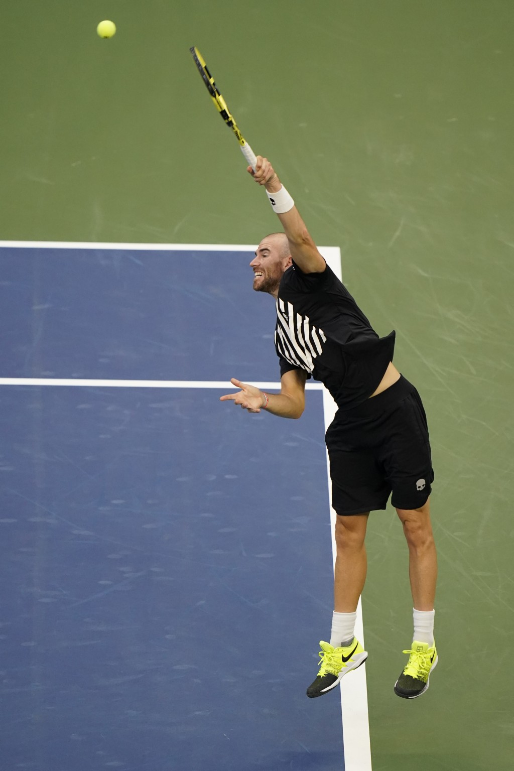 Adrian Mannarino, of France, serves to Alexander Zverev, of Germany, during the third round of the U.S. Open tennis championships, Friday, Sept. 4, 20...
