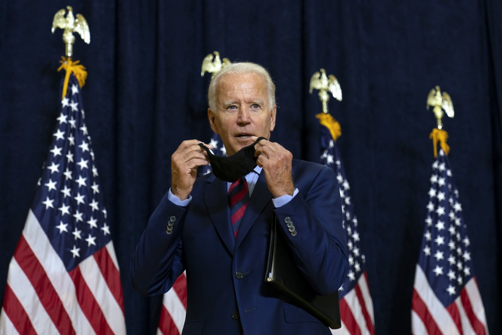 Democratic presidential candidate former Vice President Joe Biden puts on his face mask after speaking to media in Wilmington, Del., Friday Sept. 4, 2...