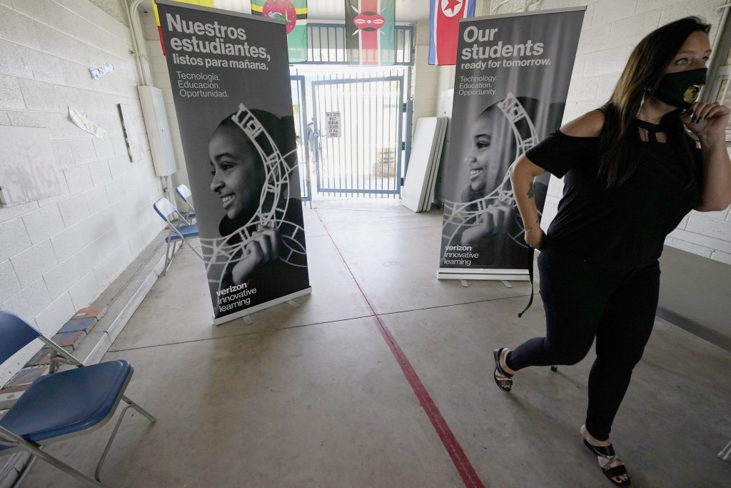 Lynette Faulkner, director at the Valencia Newcomer School, walks an empty hallway due to coronavirus and remote learning of the students, Tuesday, Se...
