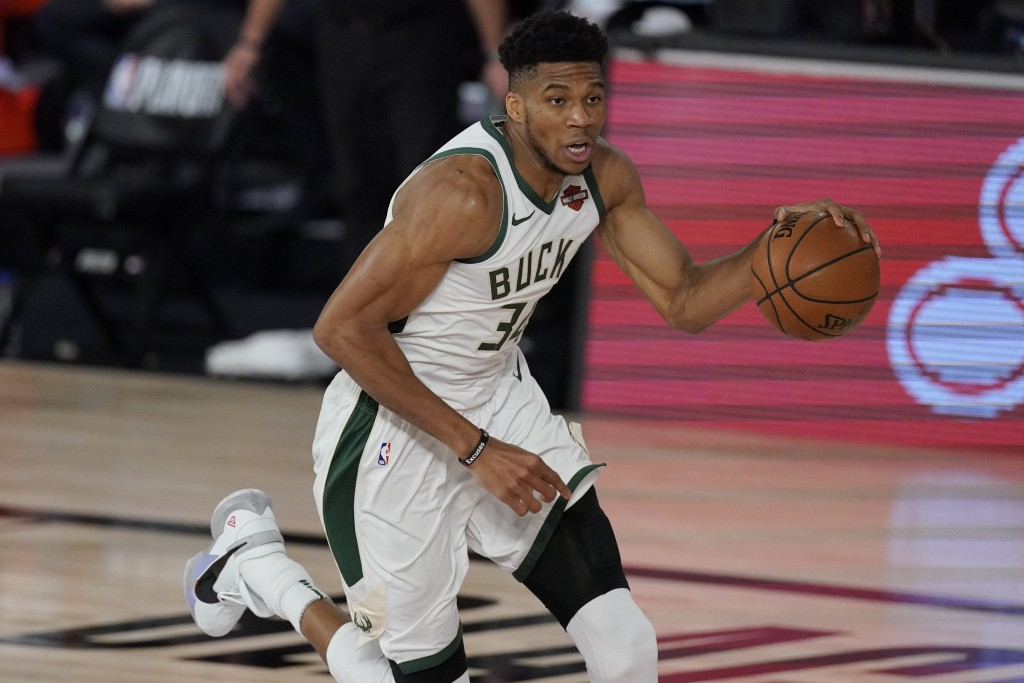 Milwaukee Bucks' Giannis Antetokounmpo (34) in the second half of an NBA conference semifinal playoff basketball game against the Miami Heat Friday, S...