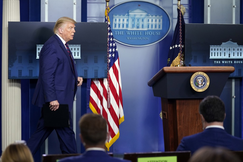 President Donald Trump arrives for a news conference in the James Brady Press Briefing Room at the White House, Friday, Sept. 4, 2020, in Washington. ...