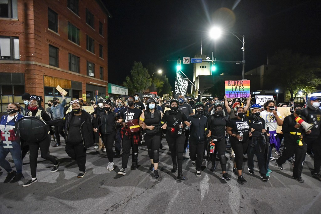 Demonstrators march along a street in Rochester, N.Y., Friday, Sept. 4, 2020, during a protest over the death of Daniel Prude. Prude apparently stoppe...