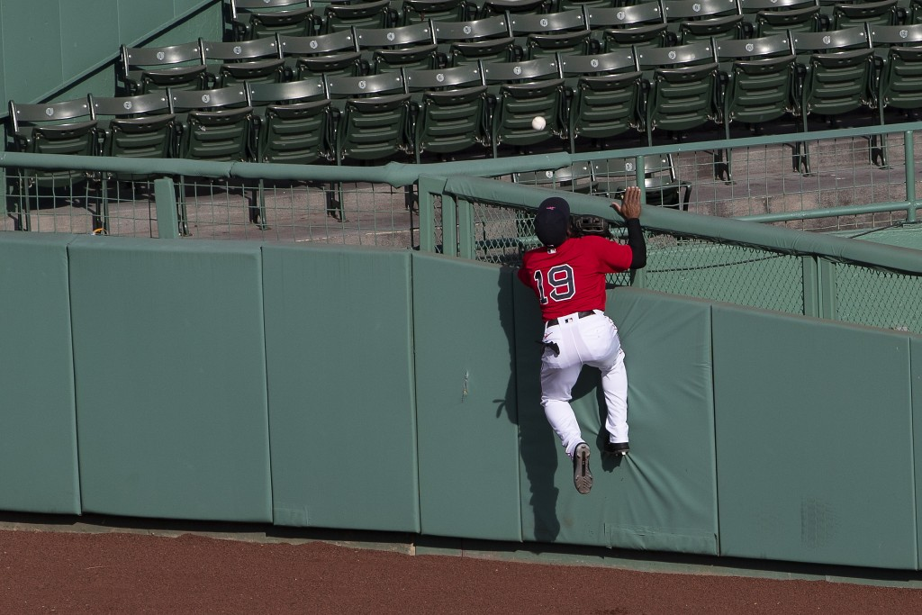 Boston Red Sox center fielder Jackie Bradley Jr. cannot get to a home run by Toronto Blue Jays' Travis Shaw during the second inning of the first game...