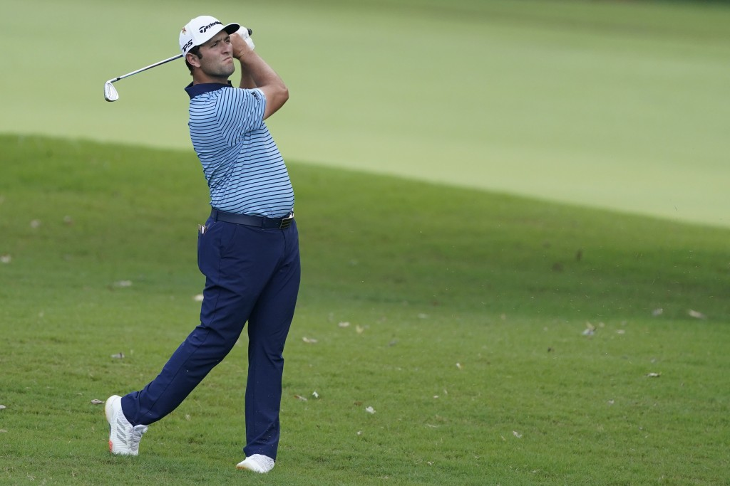 Jon Rahm, hits on the third fairway during the first round of the Tour Championship golf tournament at East Lake Golf Club in Atlanta, Friday, Sept. 4...