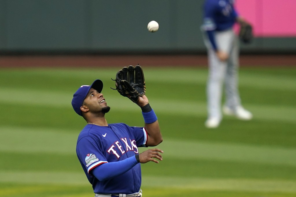 Texas Rangers shortstop Elvis Andrus snags a popup from Seattle Mariners' J.P. Crawford in the first inning of a baseball game Friday, Sept. 4, 2020, ...