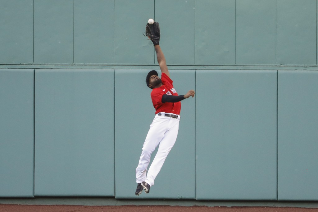 Boston Red Sox center fielder Jackie Bradley Jr. makes a leaping catch on a ball hit by Toronto Blue Jays' Rowdy Tellez during the sixth inning of the...
