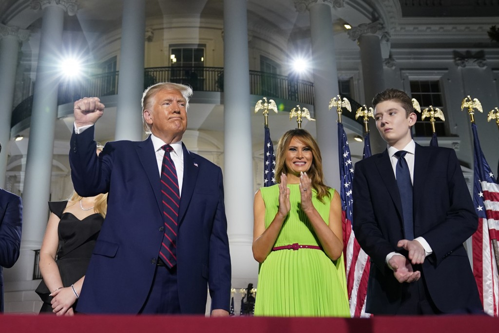 President Donald Trump, first lady Melania Trump and Barron Trump stand on the South Lawn of the White House on the fourth day of the Republican Natio...