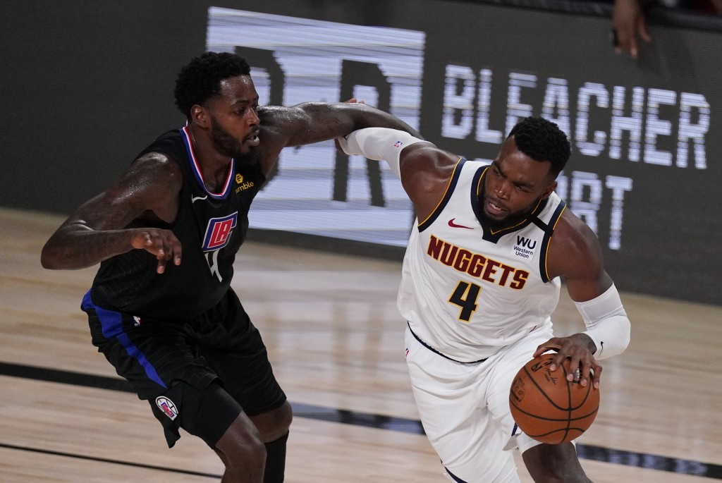 Denver Nuggets' Paul Millsap drives around Los Angeles Clippers' JaMychal Green, left, during the second half of an NBA conference semifinal playoff b...