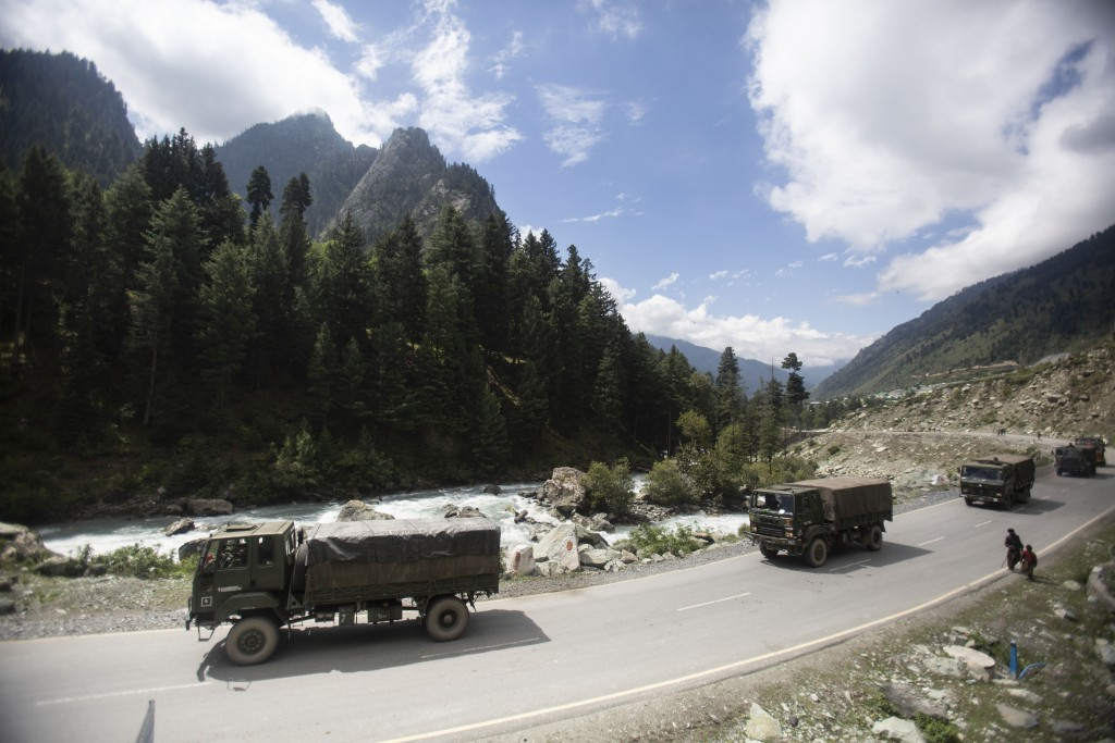 FILE - In this Tuesday, Sept. 1, 2020, file photo, an Indian army convoy moves on the Srinagar- Ladakh highway at Gagangeer, northeast of Srinagar, In...