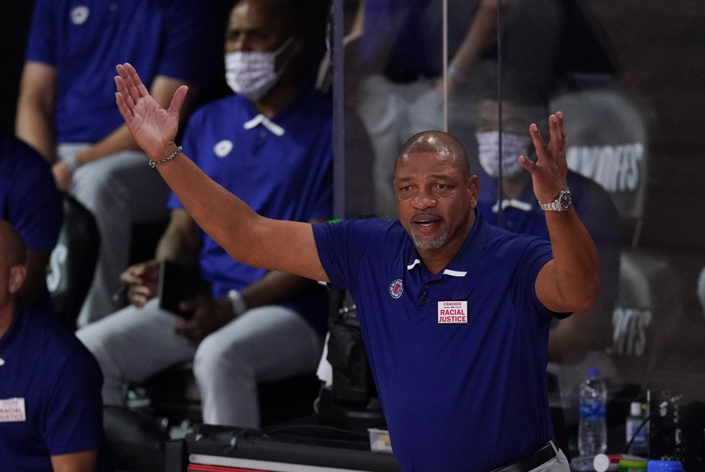 Los Angeles Clippers head coach Doc Rivers reacts on the bench during the first half of an NBA conference semifinal playoff basketball game against th...