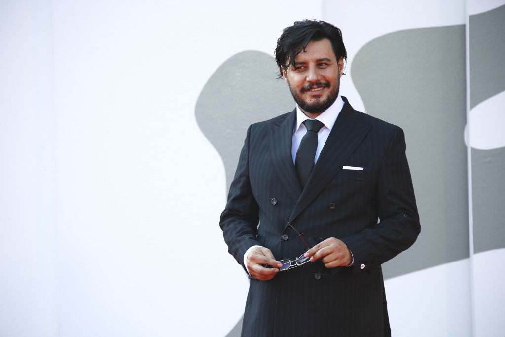 Actor Javad Ezati poses for photographers upon arrival at the premiere of the film 'Khorshid (Sun Children)' during the 77th edition of the Venice Fil...