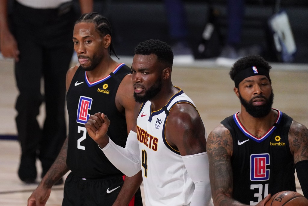 Denver Nuggets' Paul Millsap (4) reacts between Los Angeles Clippers' Kawhi Leonard (2) and Marcus Morris Sr., right, during the first half of an NBA ...