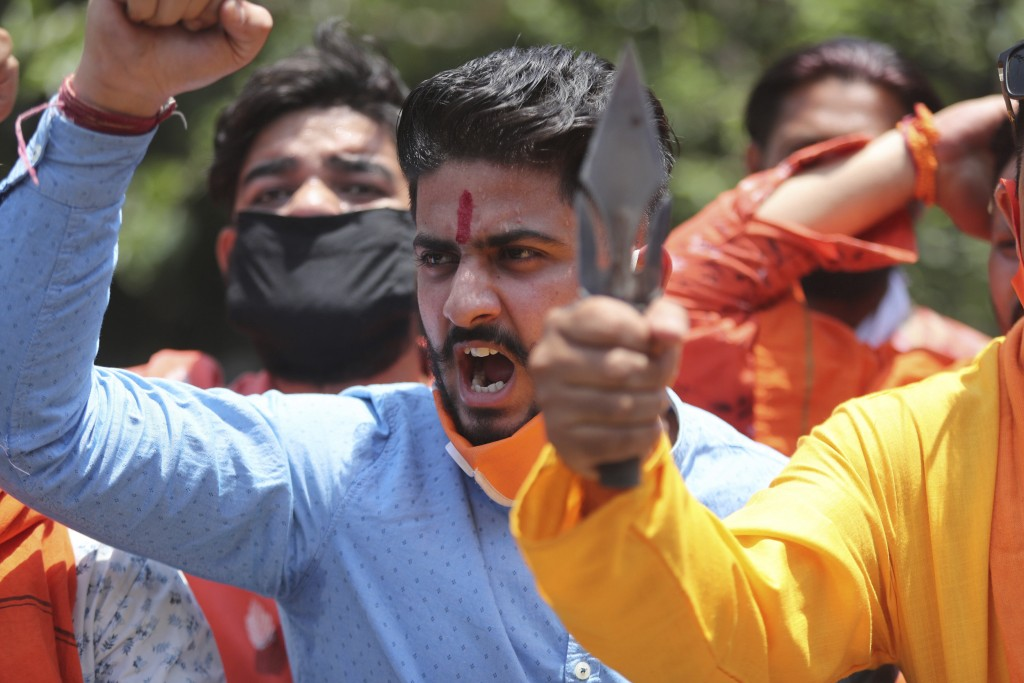 FILE - In this Wednesday, June 17, 2020, file photo, activists of Rashtriya Bajrang Dal shout slogans during a protest against the Chinese government ...
