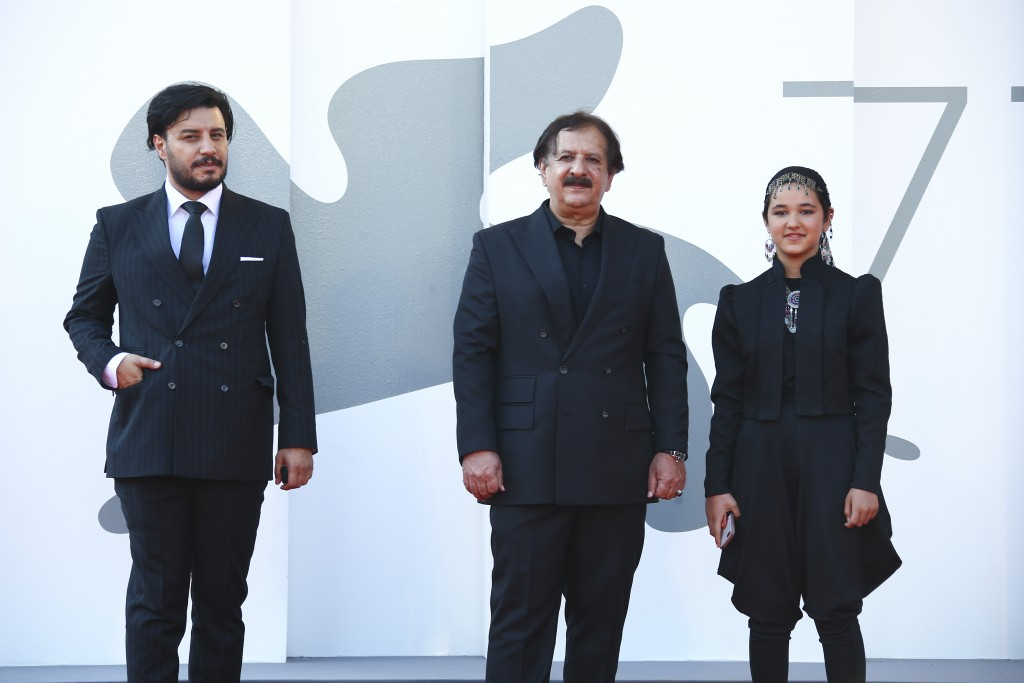 Actor Javad Ezati, from left, director Majid Majidi, and actress Shamila Shirzad pose for photographers upon arrival at the premiere of the film 'Khor...