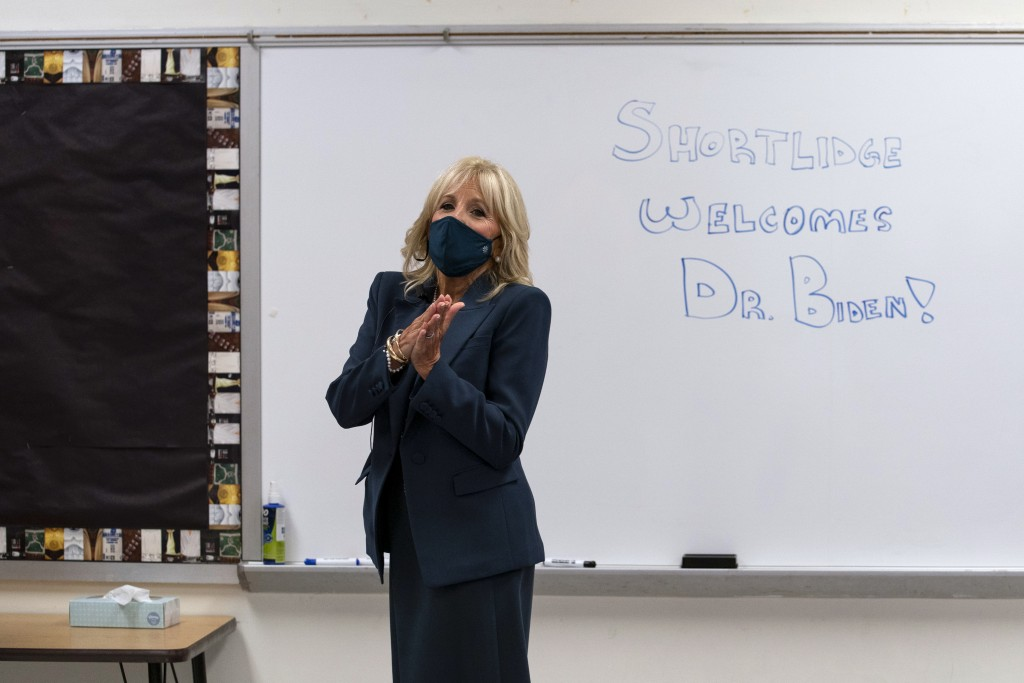 FILE - In this Sept. 1, 2020, file photo Jill Biden, wife of Democratic presidential candidate former Vice President Joe Biden, walks past a dry erase...