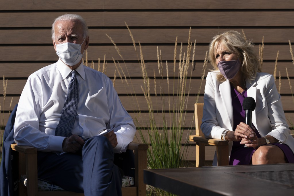 FILE - In this Sept. 3, 2020, file photo Democratic presidential candidate former Vice President Joe Biden and his wife Jill Biden talk with community...