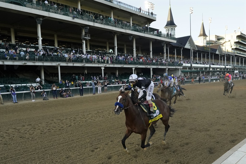 Jockey John Velazquez riding Authentic, wins the 146th running of the Kentucky Derby at Churchill Downs, Saturday, Sept. 5, 2020, in Louisville, Ky. (...