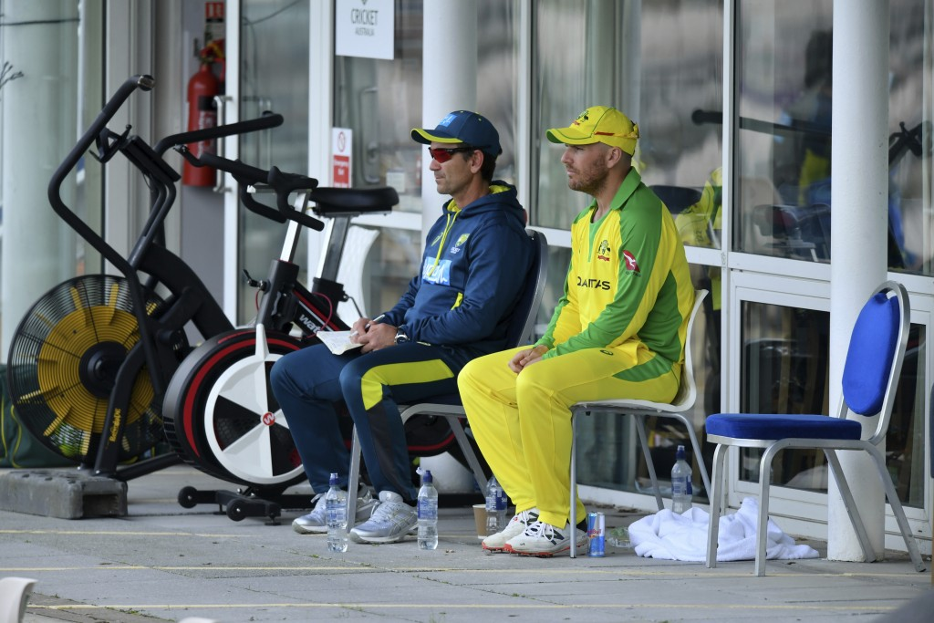 Australia's captain Aaron Finch, right, watches the game with team coach Justin Langer after being dismissed during the second Twenty20 cricket match ...