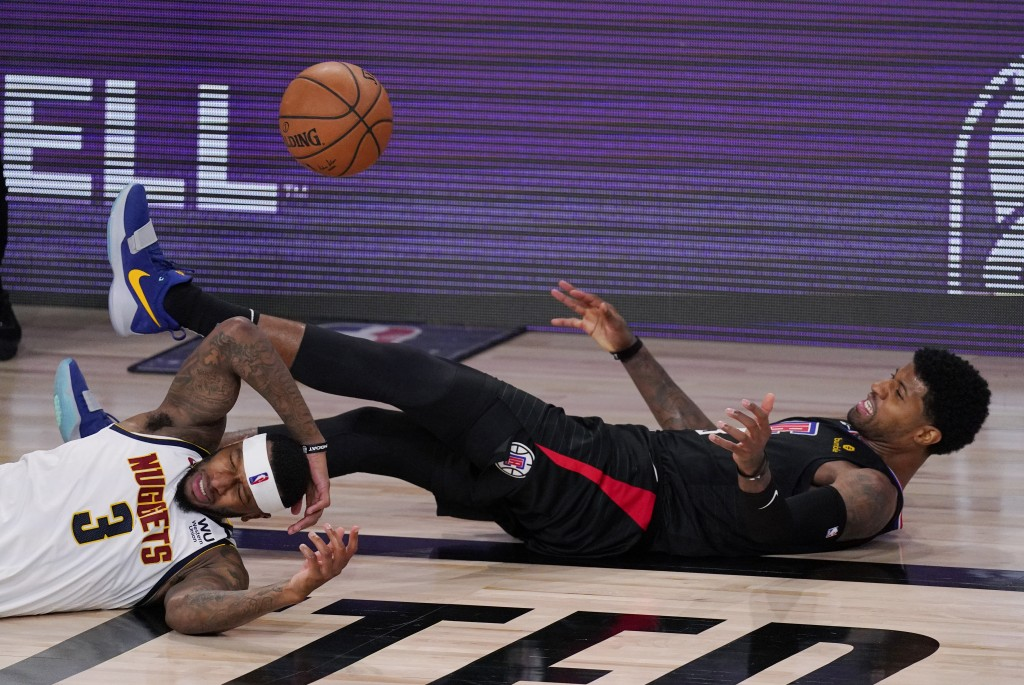 Denver Nuggets' Torrey Craig (3) fights for a loose ball with Los Angeles Clippers' Paul George, right, during the second half of an NBA conference se...
