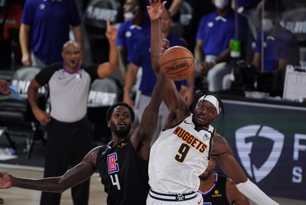 Los Angeles Clippers' JaMychal Green (4) fights for a loose ball with Denver Nuggets' Jerami Grant (9) during the second half of an NBA conference sem...