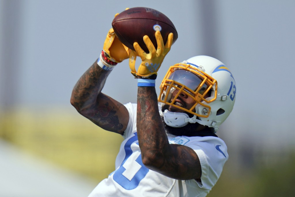 FILE - In this Aug. 19, 2020, file photo, Los Angeles Chargers wide receiver Keenan Allen makes a catch during NFL football camp in Costa Mesa, Calif....