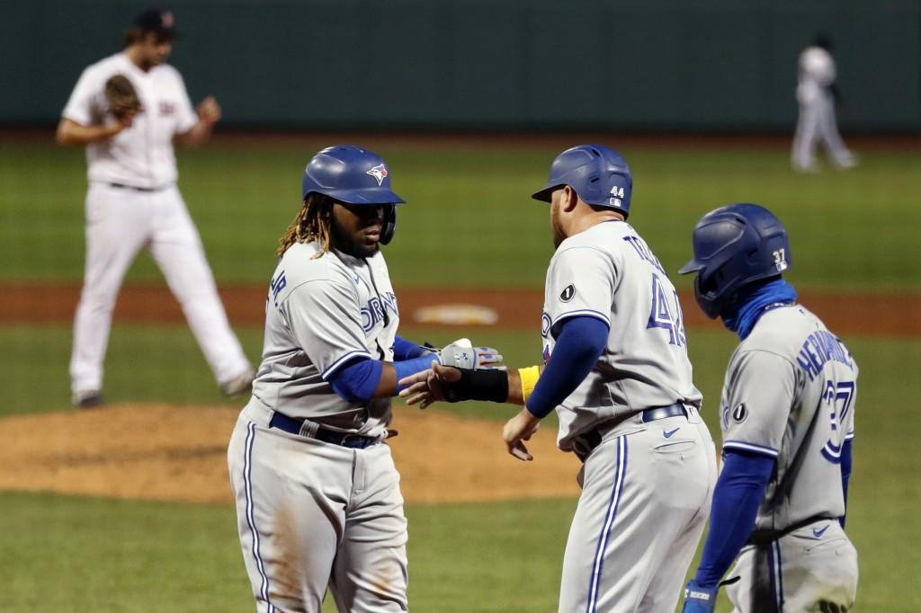 Toronto Blue Jays' Vladimir Guerrero Jr. celebrates his three-run home run that drove in Rowdy Tellez (44) and Teoscar Hernandez (37) during the sixth...