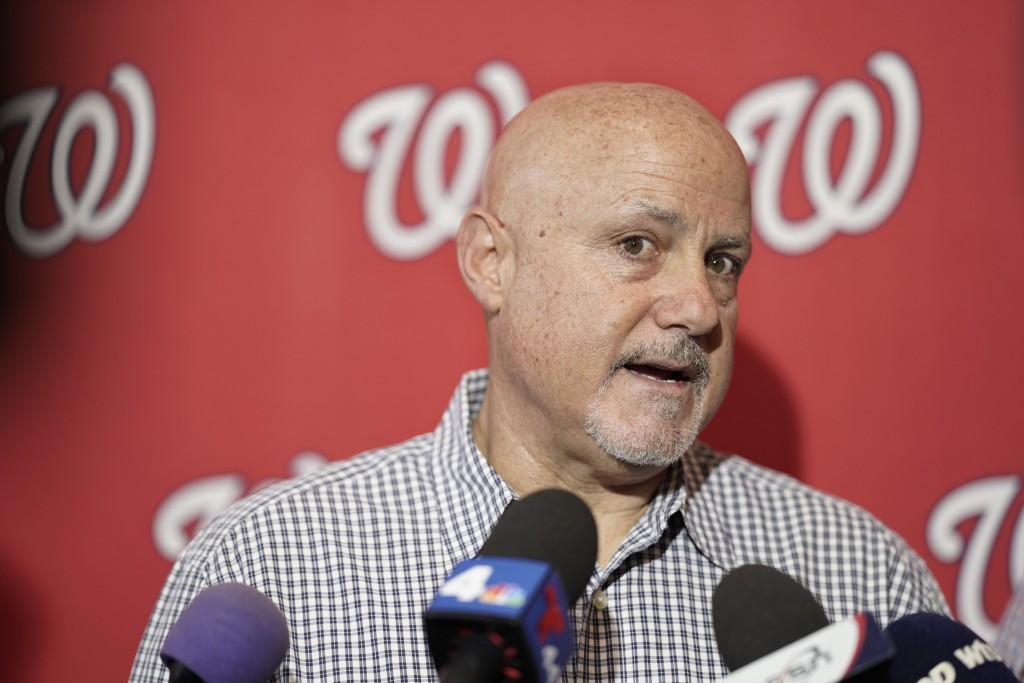 """FILE - In this Jan. 11, 2020, file photo, Washington Nationals general manager Mike Rizzo talks with members of the media during the team's """"Winterfes..."""
