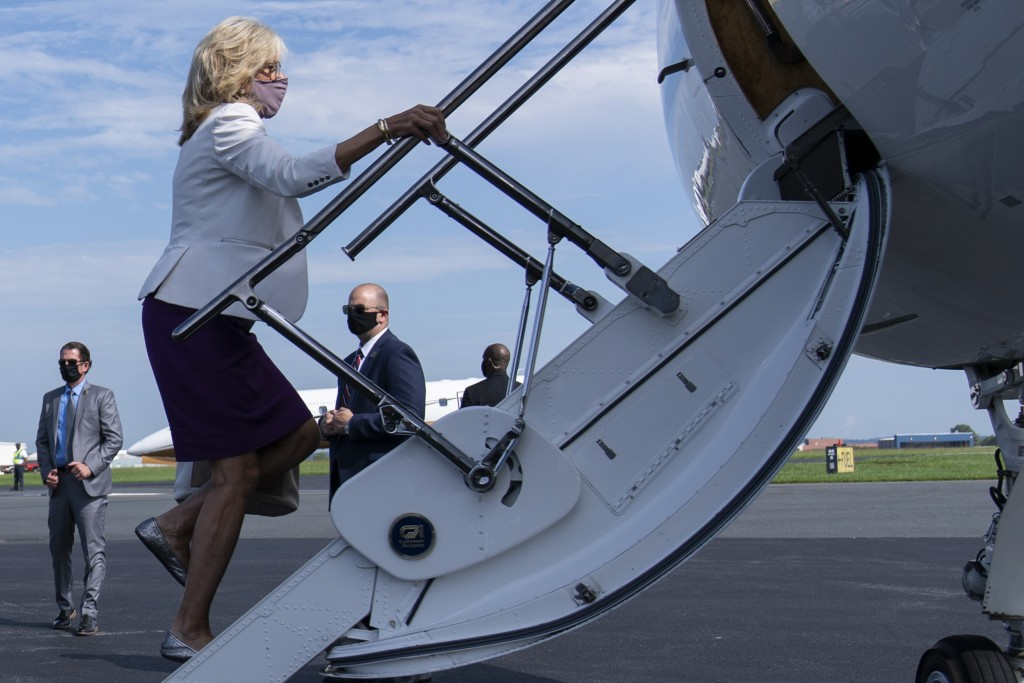 FILE - In this Sept. 3, 2020, file photo Jill Biden, wife of Democratic presidential candidate former Vice President Joe Biden, boards a plane at New ...