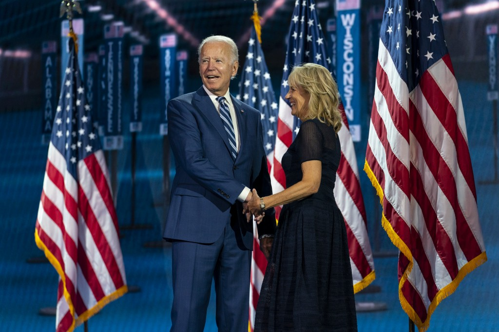 FILE - In this Aug. 19, 2020, file photo Democratic presidential candidate former Vice President Joe Biden, and his wife Jill Biden, take the stage af...