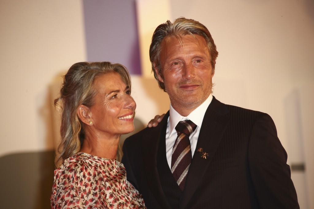 Actor Mads Mikkelsen, right, and Hanne Jacobsen pose for photographers upon arrival at the premiere of the film 'Miss Marx' during the 77th edition of...