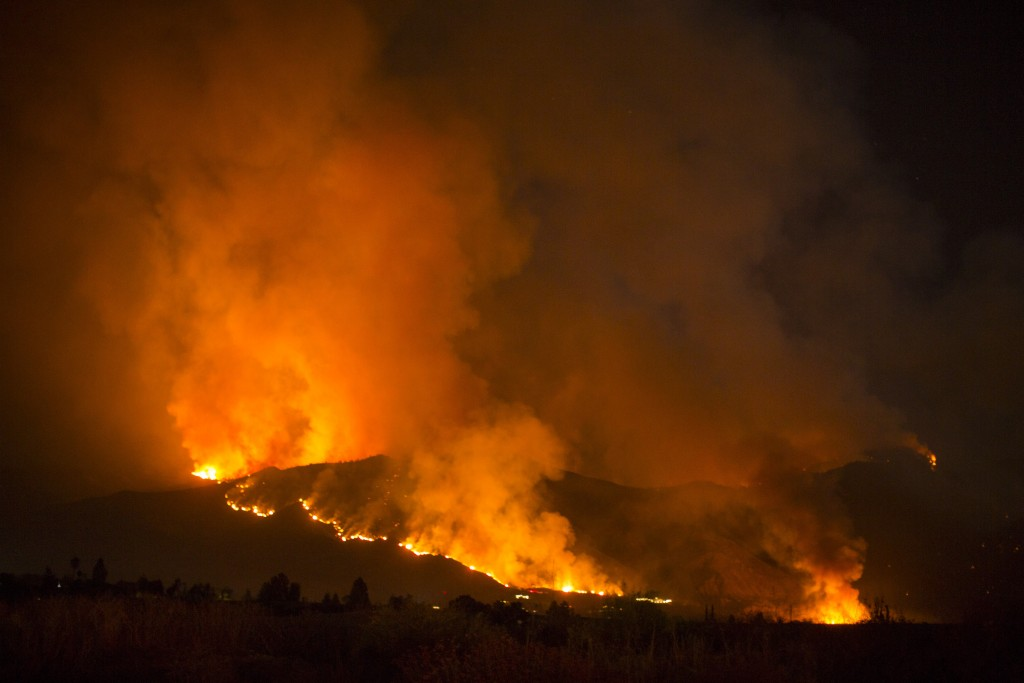 A wildfire burns in Yucaipa, Calif., Saturday, Sept. 5, 2020. Three fast-spreading California wildfires sent people fleeing Saturday, with one trappin...