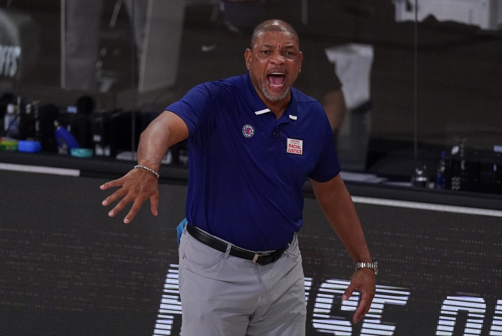 Los Angeles Clippers head coach Doc Rivers reacts to a call during the first half of an NBA conference semifinal playoff basketball game against the D...