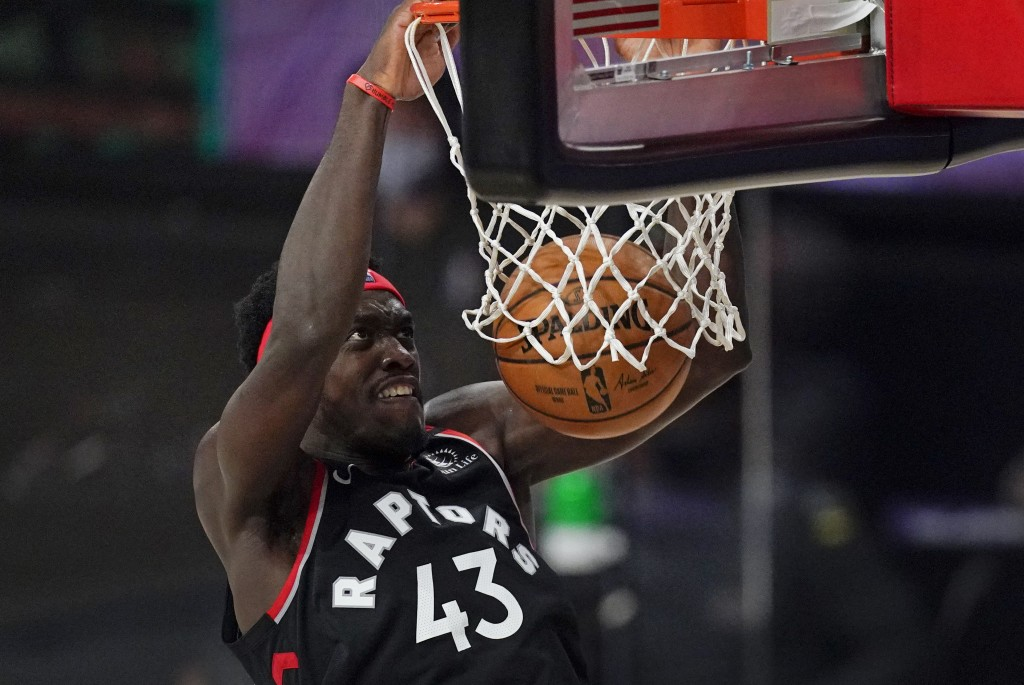 Toronto Raptors' Pascal Siakam (43) dunks the ball during the first half of an NBA conference semifinal playoff basketball game against the Boston Cel...