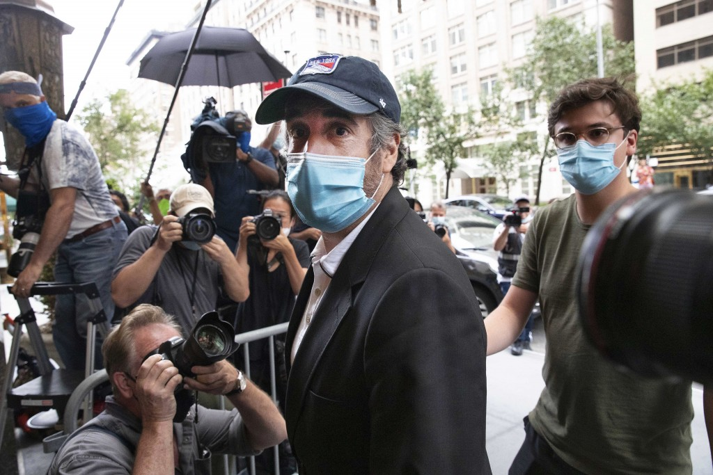 FILE - This July 24, 2020, file photo shows Michael Cohen, center, President Donald Trump's former personal attorney, returning to his apartment, in N...