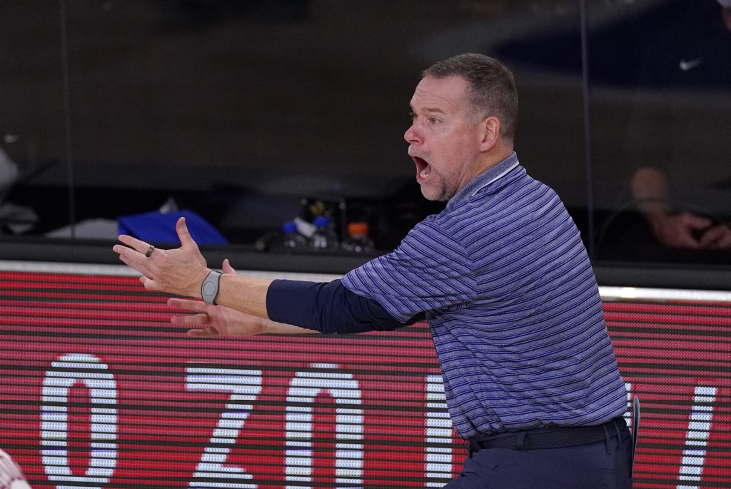 Denver Nuggets head coach Michael Malone reacts to a call during the second half of an NBA conference semifinal playoff basketball game against the Lo...