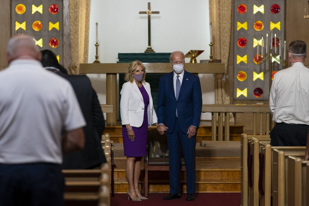 FILE- In this Sept. 3, 2020, file photo Democratic presidential candidate former Vice President Joe Biden holds hands with his wife Jill Biden during ...