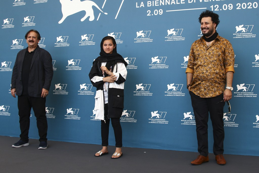 Director Majid Majidi, from left, actors Shamila Shirzad and Javad Ezati pose for photographers at the photo call for the film 'Khorshid (Sun Children...