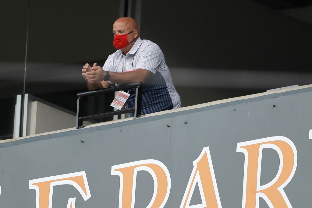 FILE - In this Aug. 14, 2020, file photo, Washington Nationals general manager Mike Rizzo looks on during the seventh inning in the continuation of a ...