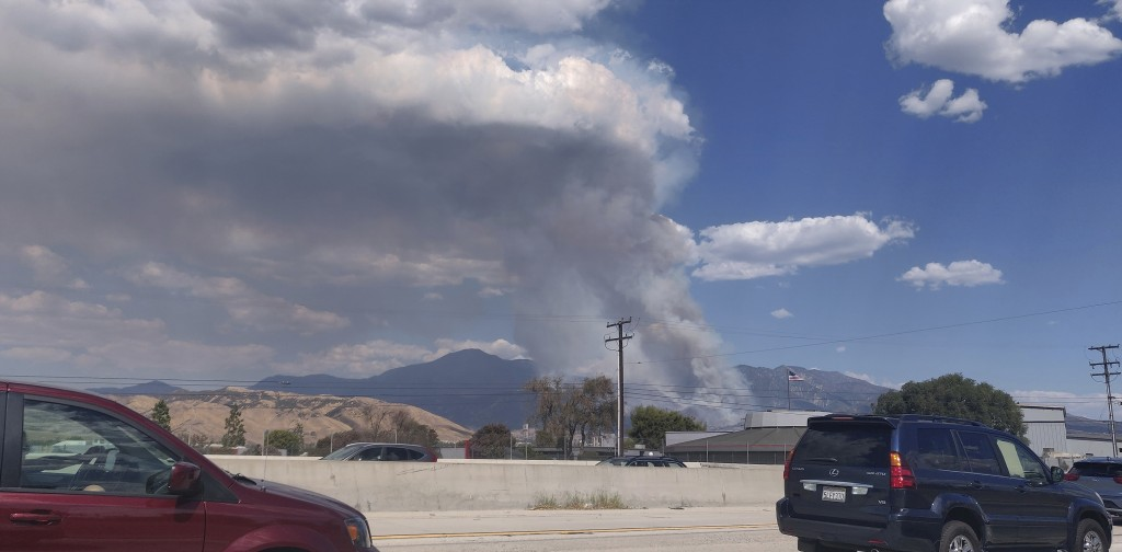 A plume of smoke from the El Dorado Fire is seen from the Interstate 10 in Loma Linda, Calif., Saturday, Sept. 5, 2020. In Southern California, a fast...