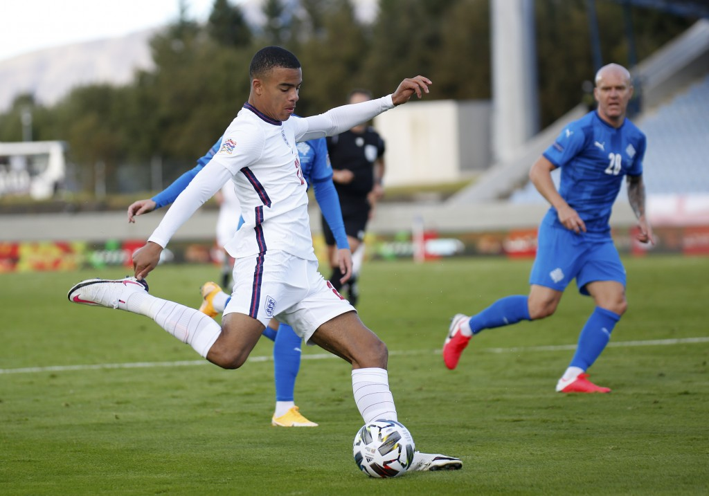 England's Mason Greenwood takes a shot during the UEFA Nations League soccer match between Iceland and England in Reykjavik, Iceland, Saturday, Sept. ...
