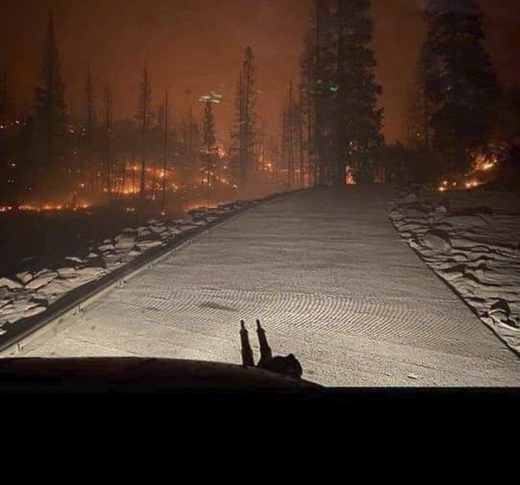 In this Saturday, Sept. 5, 2020, photo released by the California National Guard, shows the view from a Cal Guard Chinook helicopter last night rescui...